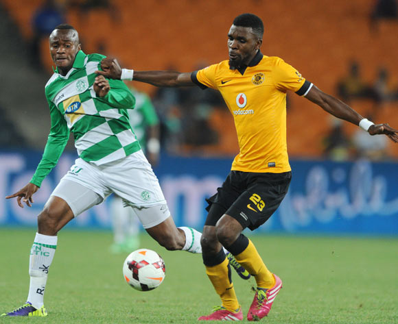 Joel Mogorosi of Bloemfontein Celtic battles with Tefu Mashamaite of Kaizer Chiefs  during the Absa Premiership 2013/14 match between Kaizer Chiefs and Bloemfontein Celtic at FNB Stadium in Johannesburg on the 19 February 2014