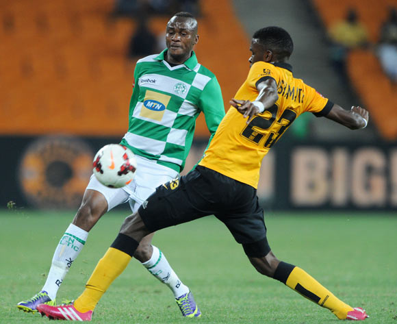 Joel Mogorosi of Bloemfontein Celtic challenged by Tefu Mashamaite of Kaizer Chiefs during the Absa Premiership 2013/14 match between Kaizer Chiefs and Bloemfontein Celtic at FNB Stadium in Johannesburg on the 19 February 2014