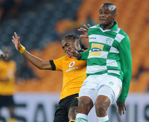 Joel Mogorosi of Bloemfontein Celtic tackled by Siphiwe Tshabalala of Kaizer Chiefs  during the Absa Premiership 2013/14 match between Kaizer Chiefs and Bloemfontein Celtic at FNB Stadium in Johannesburg on the 19 February 2014