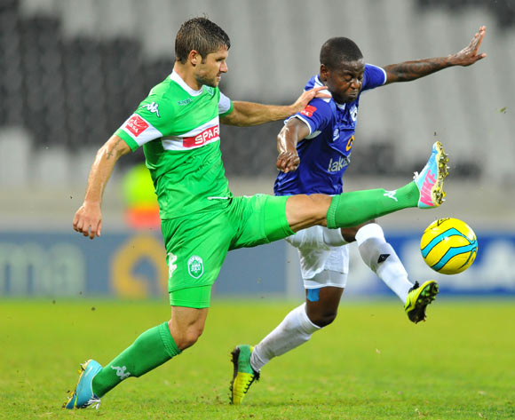 Clifford Ngobeni of Black Aces challenged by Marc Van heerden of Amazulu during the Absa Premiership football match between Black Aces and AmaZulu at the Mbombela Stadium, Nelspruit on the 19 February 2014