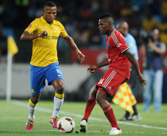 Khethowakhe Masuku of Orlando Pirates challenged by Mzikayise Mashaba of Mamelodi Sundowns during the Absa Premiership 2013/14 match between Mamelodi Sundowns and Orlando Pirates at Loftus Stadium in Pretoria on the 25 February 2014
