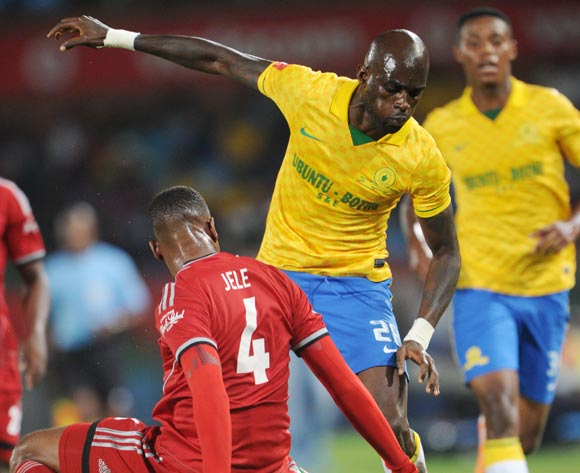 Anthony Laffor of Mamelodi Sundowns tackled by Happy Jele of Orlando Pirates  during the Absa Premiership 2013/14 match between Mamelodi Sundowns and Orlando Pirates at Loftus Stadium in Pretoria on the 25 February 2014