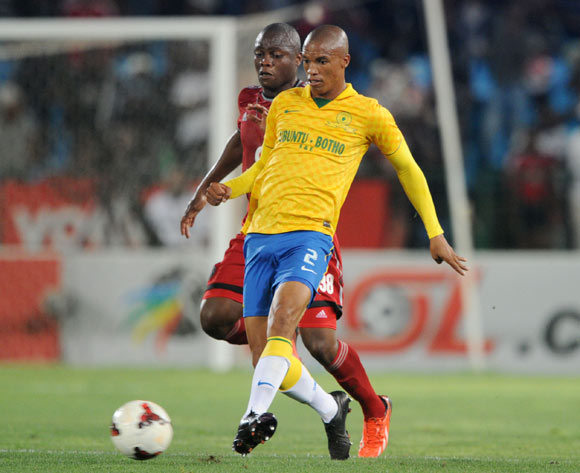 Thabo Nthethe of Mamelodi Sundowns challenged by Helder Pelembe of Orlando Pirates during the Absa Premiership 2013/14 match between Mamelodi Sundowns and Orlando Pirates at Loftus Stadium in Pretoria on the 25 February 2014