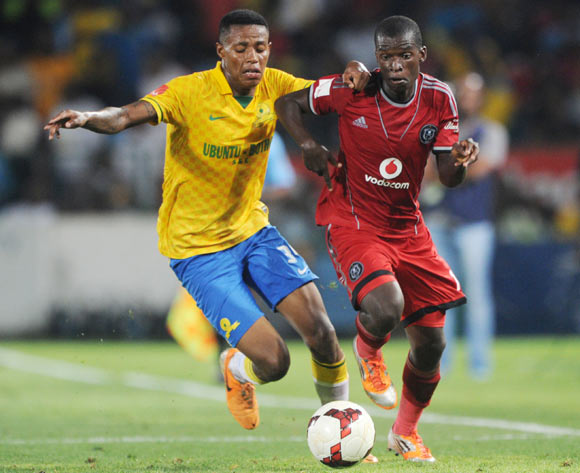 Sifiso Myeni of Orlando Pirates challenged by Bongani Zungu of Mamelodi Sundowns during the Absa Premiership 2013/14 match between Mamelodi Sundowns and Orlando Pirates at Loftus Stadium in Pretoria on the 25 February 2014