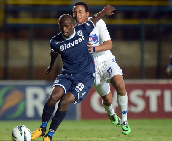Kwanda Mngonyama of Bidvest Wits battles with Joao Oliveira of Supersport United  during the Absa Premiership match between Bidvest Wits and Supersport United on the 25 February 2014 at Bidvest Stadium