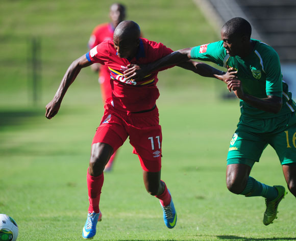 Thabo Mosadi of University Pretoria battles Nkanyiso cele of Golden Arrows during the Absa Premiership 2013/14 football match between  Golden Arrows and University of Pretoria at the King Zwelithini Stadium in Durban , Kwa-Zulu Natal on the 1st of March 2