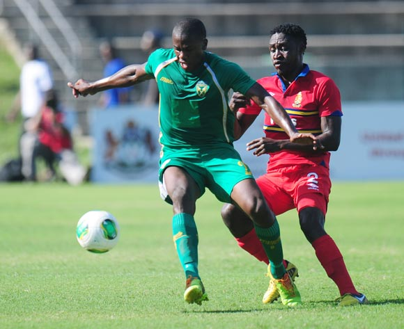 Bongi Ntuli of Golden Arrows battles Siyabonga Shoyisa of University Pretoria during the Absa Premiership 2013/14 football match between  Golden Arrows and University of Pretoria at the King Zwelithini Stadium in Durban , Kwa-Zulu Natal on the 1st of Marc