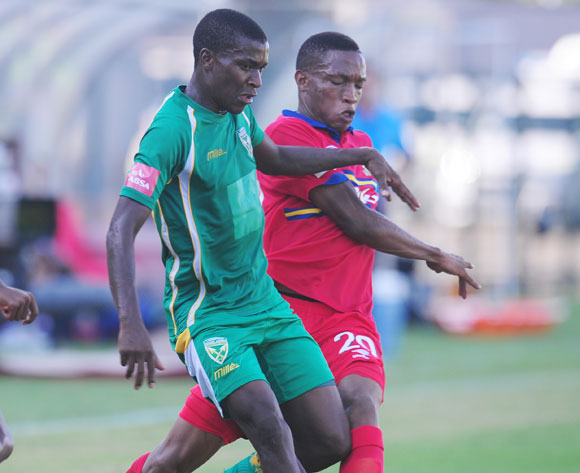 Philani Shange of Golden Arrows challenged by Grant Kekana of University Pretoria during the Absa Premiership 2013/14 football match between  Golden Arrows and University of Pretoria at the King Zwelithini Stadium in Durban , Kwa-Zulu Natal on the 1st of