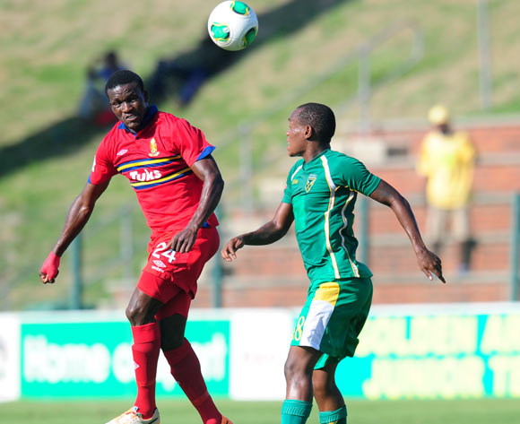 Ronald Ketjijere of University Pretoria and Thembela Sikhakhane of Golden Arrows during the Absa Premiership 2013/14 football match between  Golden Arrows and University of Pretoria at the King Zwelithini Stadium in Durban , Kwa-Zulu Natal on the 1st of M