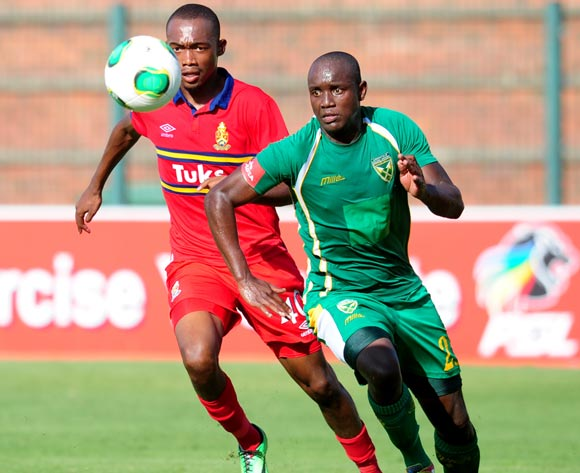 Thabo Mnyamane of University Pretoria and Jabulani Nene of Golden Arrows during the Absa Premiership 2013/14 football match between  Golden Arrows and University of Pretoria at the King Zwelithini Stadium in Durban , Kwa-Zulu Natal on the 1st of March 201