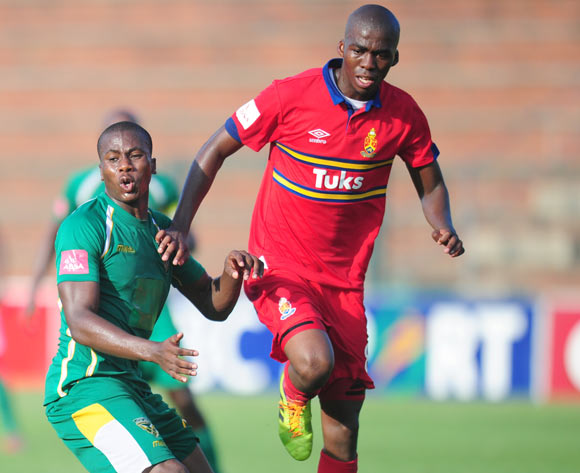 Bongi Ntuli of Golden Arrows and Mpho Matsi of University Pretoria during the Absa Premiership 2013/14 football match between  Golden Arrows and University of Pretoria at the King Zwelithini Stadium in Durban , Kwa-Zulu Natal on the 1st of March 2014