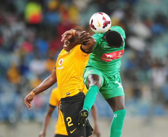 Willard Katsande of Kaizer Chiefs  battles Jerry of Liga Macumalama during the CAF Orange Champions League 2014/15 football match between Kaizer Chiefs v Liga Muculmana at the Moses Mabhida Stadium in Durban , Kwa-Zulu Natal on the 1st of March 2014