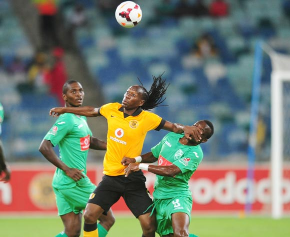 Reneilwe Letsholonyane of Kaizer Chiefs battles Liberty of Liga Macumalama during the CAF Orange Champions League 2014/15 football match between Kaizer Chiefs v Liga Muculmana at the Moses Mabhida Stadium in Durban , Kwa-Zulu Natal on the 1st of March 201