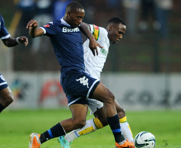 Teko Modise of Mamelodi Sundowns challenged by Sibusiso Vilakazi of Bidvest Wits during the Absa Premiership 2013/14 match between Bidvest Wits and Mamelodi Sundowns at Bidvest Stadium in Johannesburg on the 01 March 2014