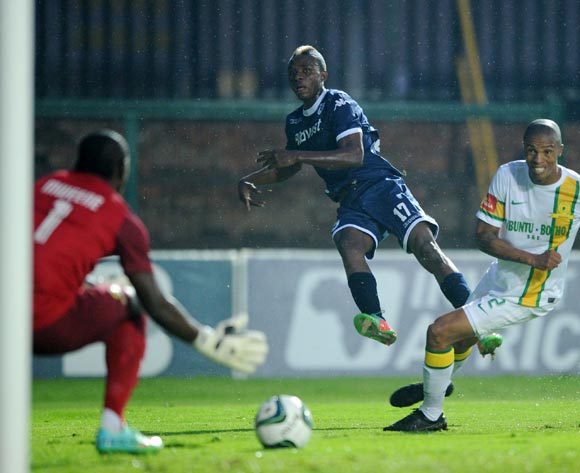 Papy Faty of Bidvest Wits takes a shot at goal while challenged by Thabo Nthethe of Mamelodi Sundowns during the Absa Premiership 2013/14 match between Bidvest Wits and Mamelodi Sundowns at Bidvest Stadium in Johannesburg on the 01 March 2014