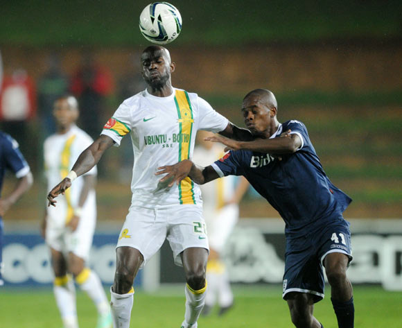 Anthony Laffor of Mamelodi Sundowns battles with Phumlani Ntshangase of Bidvest Wits during the Absa Premiership 2013/14 match between Bidvest Wits and Mamelodi Sundowns at Bidvest Stadium in Johannesburg on the 01 March 2014