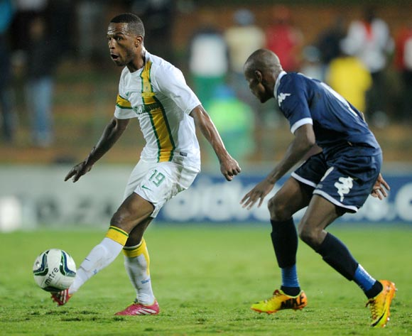 Mzikayise Mashaba of Mamelodi Sundowns challenged by Calvin Kadi of Bidvest Wits during the Absa Premiership 2013/14 match between Bidvest Wits and Mamelodi Sundowns at Bidvest Stadium in Johannesburg on the 01 March 2014
