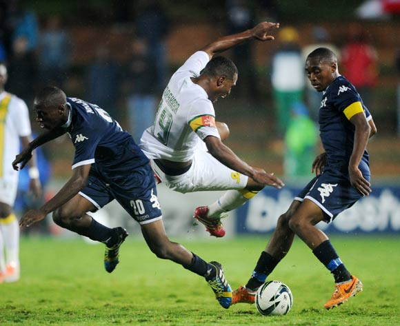 Mzikayise Mashaba of Mamelodi Sundowns battles with Sibusiso Vilakazi and Siyabonga Nhlapho of Bidvest Wits during the Absa Premiership 2013/14 match between Bidvest Wits and Mamelodi Sundowns at Bidvest Stadium in Johannesburg on the 01 March 2014