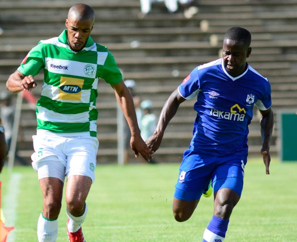 Wandisile Letlabika of Bloemfontein Celtic and Clifford Ngobeni of Black Aces  during the Absa Premiership match between Bloemfontein Celtic and MP Black Aces on 2 March 2014 at   Kaizer Sebothelo Stadium