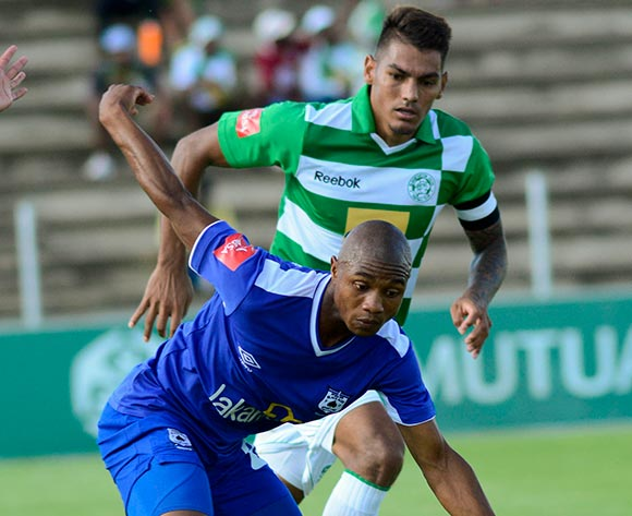 Thabo Qalinge of MP Black Aces and Clayton Daniels of Bloemfontein Celtic during the Absa Premiership match between Bloemfontein Celtic and MP Black Aces on 2 March 2014 at Kaizer Sebothelo Stadium