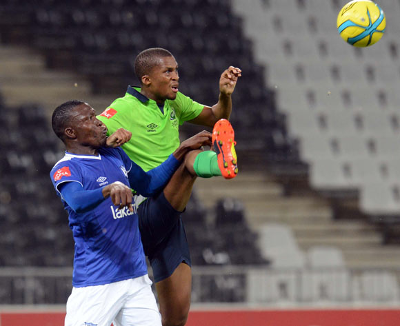 Tshepo Gumede of Platinum Stars battles with Tendai Ndoro of Black Aces during the Absa Premiership match between MP Black Aces and Platinum Stars  on the 07 March 2014 at Mbombela Stadium