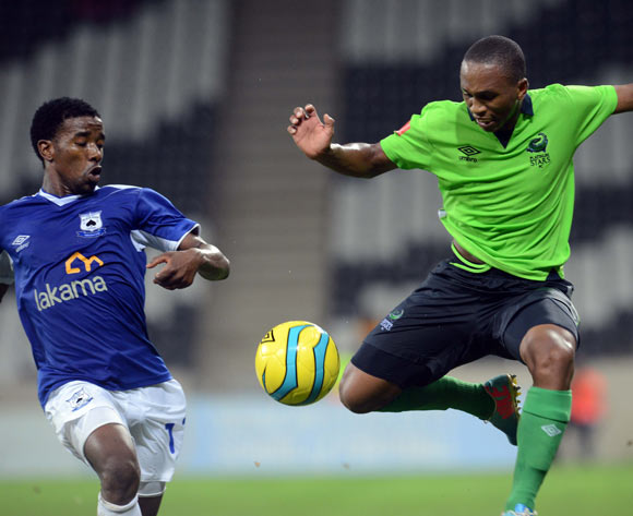 Abia Nale of Black Aces battles with Luvolwethu Mpeta of Platinum Stars  during the Absa Premiership match between MP Black Aces and Platinum Stars  on the 07 March 2014 at Mbombela Stadium