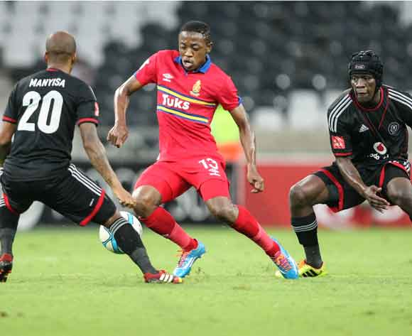 Oupa Manyisa of Orlando Pirates challenges Raymond Monama of University Pretoria during the Absa Premiership 2013-14 match between University of Pretoria and Orlando Pirates in Mbombela Stadium, Nelspruit on the 8th March 2014.
