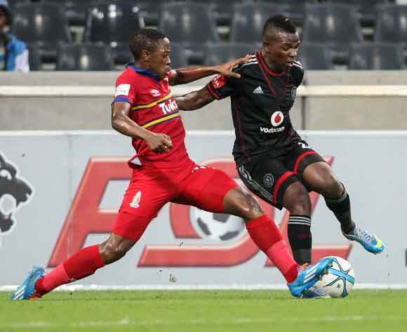 Khethokwakhe Masuku of Orlando Pirates challenged by Raymond Monama of University Pretoria during the Absa Premiership 2013-14 match between University of Pretoria and Orlando Pirates in Mbombela Stadium, Nelspruit on the 8th March 2014.