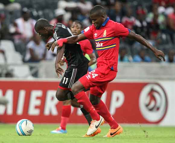 Sifiso Myeni and Ronald Ketjijere during the Absa Premiership 2013-14 match between University of Pretoria and Orlando Pirates in Mbombela Stadium, Nelspruit on the 8th March 2014.