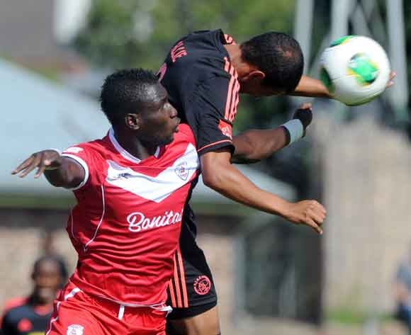 Basit Adam of Free State Stars battles with Nazeer Allie of Ajax Cape Town during the Absa Premiership 2013/14 match between Free State Stars and Ajax Cape Town at Goble Park in Bethlehem on the 08 March 2014 ©Muzi Ntombela/BackpagePix