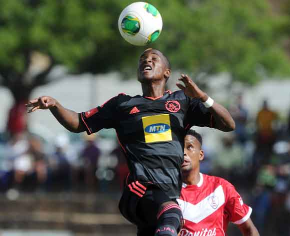 Stelio Ernesto of Ajax Cape town battles with Bokang Tlhone of Free State Stars during the Absa Premiership 2013/14 match between Free State Stars and Ajax Cape Town at Goble Park in Bethlehem on the 08 March 2014 ©Muzi Ntombela/BackpagePix