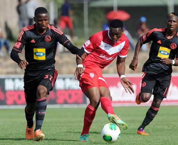 Mthokozisi Yende of Free State Stars battles with Thamsanqa Sangweni of Ajax Cape Town during the Absa Premiership 2013/14 match between Free State Stars and Ajax Cape Town at Goble Park in Bethlehem on the 08 March 2014 ©Muzi Ntombela/BackpagePix