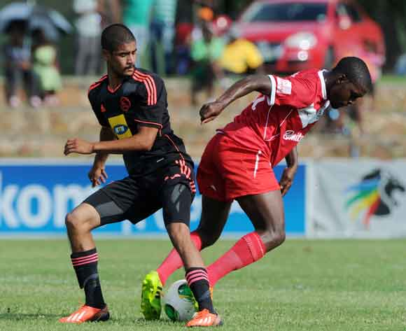 Katlego Mashego of Free State Stars battles with Abbubaker Mobara of Ajax Cape Town during the Absa Premiership 2013/14 match between Free State Stars and Ajax Cape Town at Goble Park in Bethlehem on the 08 March 2014 ©Muzi Ntombela/BackpagePix