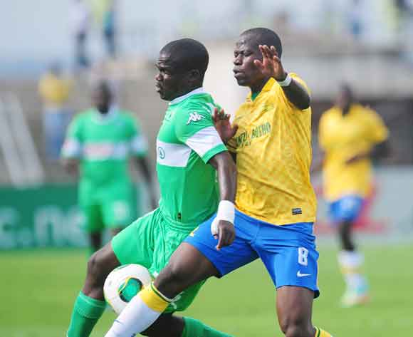 Goodman Dlamini of AmaZulu battles Hlompho Kekana of Mamelodi Sundowns during the Absa Premiership 2013/14 football match between AmaZulu and Mamelodi Sundowns at the Princess Magogo Stadium in Durban , Kwa-Zulu Natal on the 6th of March 2014  ©Sabelo Mng