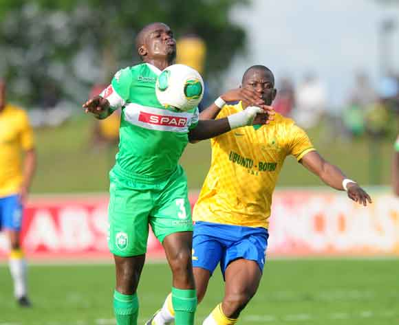 Goodman Dlamini of AmaZulu and Hlompho Kekana of Mamelodi Sundowns during the Absa Premiership 2013/14 football match between AmaZulu and Mamelodi Sundowns at the Princess Magogo Stadium in Durban , Kwa-Zulu Natal on the 6th of March 2014  ©Sabelo Mngoma/