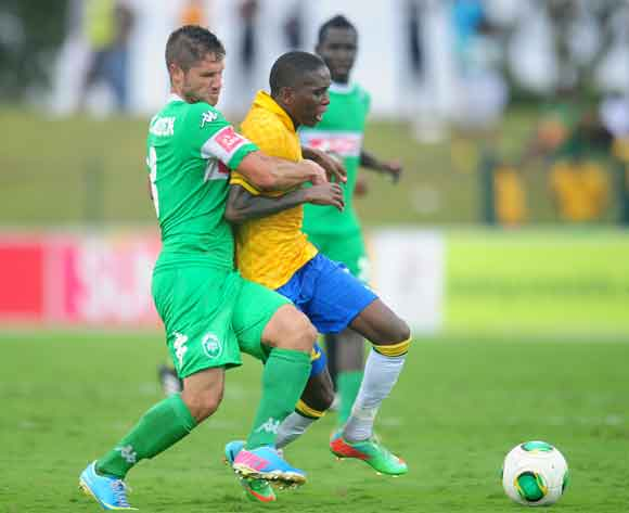 Marc Van heerden of AmaZulu battles Elias Pelembe of Mamelodi Sundowns during the Absa Premiership 2013/14 football match between AmaZulu and Mamelodi Sundowns at the Princess Magogo Stadium in Durban , Kwa-Zulu Natal on the 6th of March 2014  ©Sabelo Mng