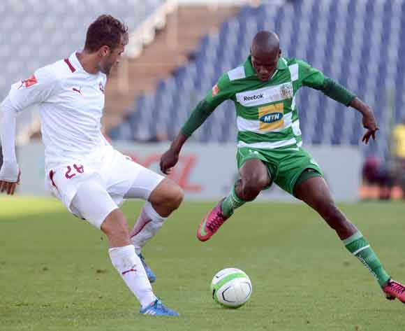 Lerato Lamola of Bloemfontein Celtic battles with Larry Cohen of Moroka Swallows during the Absa Premiership match between Moroka Swallows and Bloemfontein Celtic on the 09 March 2014 at Dobsonville Stadium  © Sydney Mahlangu/BackpagePix