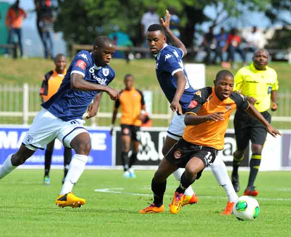 Puleng Tlolane of Polokwane City challenged by Jabulani Shongwe of Bidvest Wits during the Absa Premiership football match between Polokwane City v Bidvest Wits at the Old Peter Mokaba Stadium, Limpopo on 03 March 2014 ©Samuel Shivambu/BackpagePix