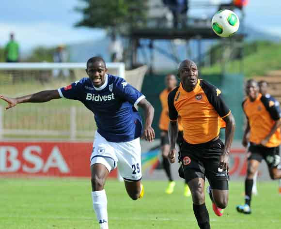 Esau Kanyenda of Polokwane City challenged by Kwanda Mngonyama of Bidvest Wits during the Absa Premiership football match between Polokwane City v Bidvest Wits at the Old Peter Mokaba Stadium, Limpopo on 03 March 2014 ©Samuel Shivambu/BackpagePix