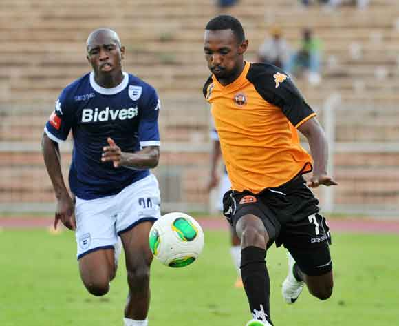 Thabo Rakhale of Polokwane City challenged by Siyabonga Nhlapho of Bidvest Wits during the Absa Premiership football match between Polokwane City v Bidvest Wits at the Old Peter Mokaba Stadium, Limpopo on 03 March 2014 ©Samuel Shivambu/BackpagePix