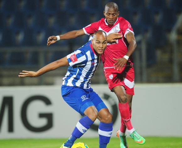 Robyn Johannes of Maritzburg United battles Richard Henyekane of Free State Stars during the Absa Premiership 2013/14 football match between Maritzburg United v Free State Starsat the Harry Gwala Stadium in Pietermaritzburg , Kwa-Zulu Natal on the 11th of