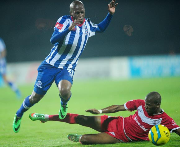 Kurt Lentjies of Maritzburg United tackled by Richard Henyekane of Free State Stars during the Absa Premiership 2013/14 football match between Maritzburg United v Free State Stars at the Harry Gwala Stadium in Pietermaritzburg , Kwa-Zulu Natal on the 11th