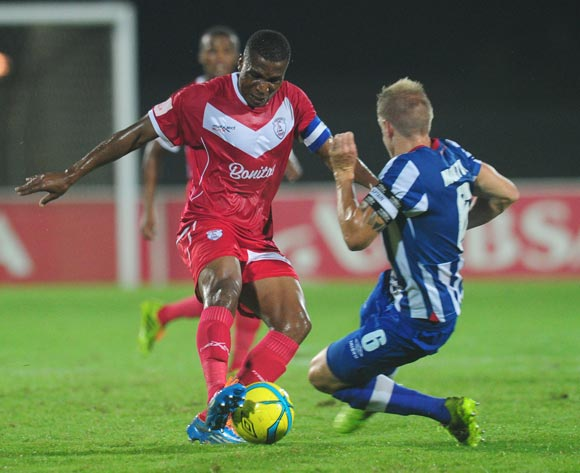 Paulus Masehe of Free State Stars battles Michael Morton of Maritzburg United during the Absa Premiership 2013/14 football match between Maritzburg United v Free State Stars at the Harry Gwala Stadium in Pietermaritzburg , Kwa-Zulu Natal on the 11th of Ma