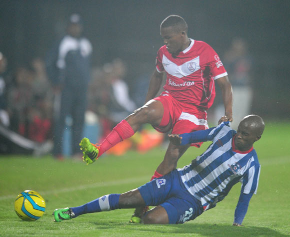 Angelo Kerspuy of Free State Stars tackled by Bhongolwethu Jayiya of Maritzburg United during the Absa Premiership 2013/14 football match between Maritzburg United v Free State Stars at the Harry Gwala Stadium in Pietermaritzburg , Kwa-Zulu Natal on the 1