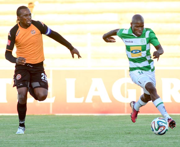 Lerato Lamola of Bloemfontein Celtic and Thapelo Tshilo of Polokwane City F.C during the Absa Premiership match between Bloemfontein Celtic and Polokwane City F C on 12 March 2014 at  Kaizer Sebothelo Stadium