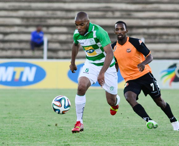 Wandisile Letlabika of Bloemfontein Celtic Thabo Rakhale of Polokwane City F.C during the Absa Premiership match between Bloemfontein Celtic and Polokwane City F C on 12 March 2014 at  Kaizer Sebothelo Stadium
