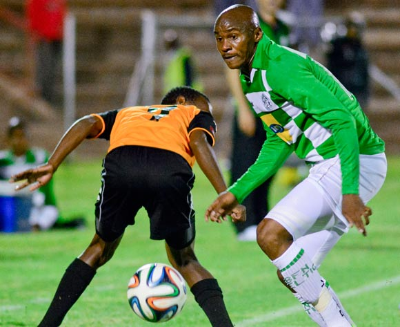 Joel Mogorosi of Bloemfontein Celtic  Thabo Rakhale of Polokwane City F C during the Absa Premiership match between Bloemfontein Celtic and Polokwane City F C on 12 March 2014 at Kaizer Sebothelo Stadium