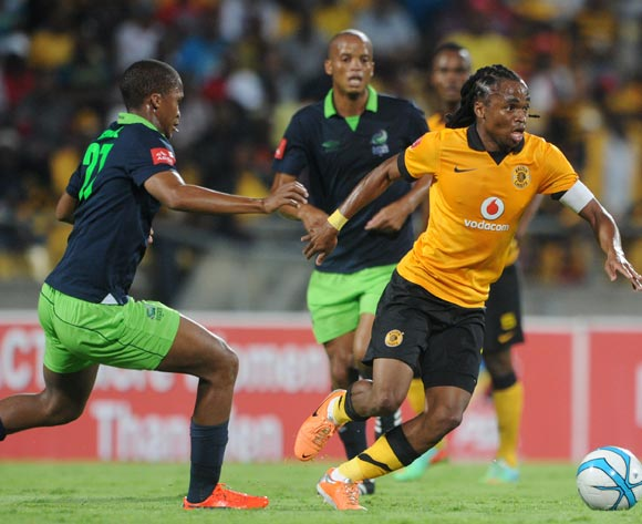 Siphiwe Tshabalala of Kaizer Chiefs challenged by Tshepo Gumede of Platinum Stars during the Absa Premiership 2013/14 match between Platinum Stars and Kaizer Chiefs at Royal Bafokeng Stadium in Rustenburg on the 12 March 2014