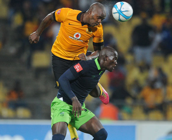 Siphelele Mthembu of Platinum Stars battles with Morgan Gould of Kaizer Chiefs during the Absa Premiership 2013/14 match between Platinum Stars and Kaizer Chiefs at Royal Bafokeng Stadium in Rustenburg on the 12 March 2014