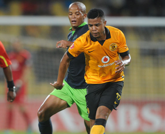 George Lebese of Kaizer Chiefs challenged by Solomon Mathe of Platinum Stars during the Absa Premiership 2013/14 match between Platinum Stars and Kaizer Chiefs at Royal Bafokeng Stadium in Rustenburg on the 12 March 2014
